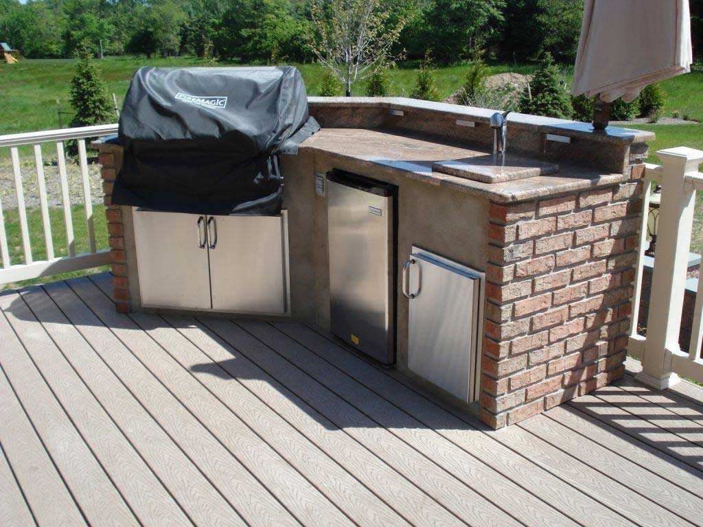Stonework brings a balance of modern traditional to for Deck kitchen ideas