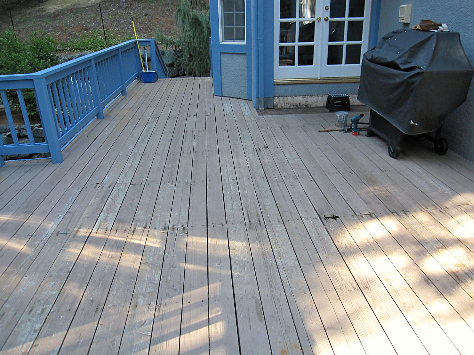 Before and after wooden decks vs composite deck amazing deck for Redwood vs composite decking