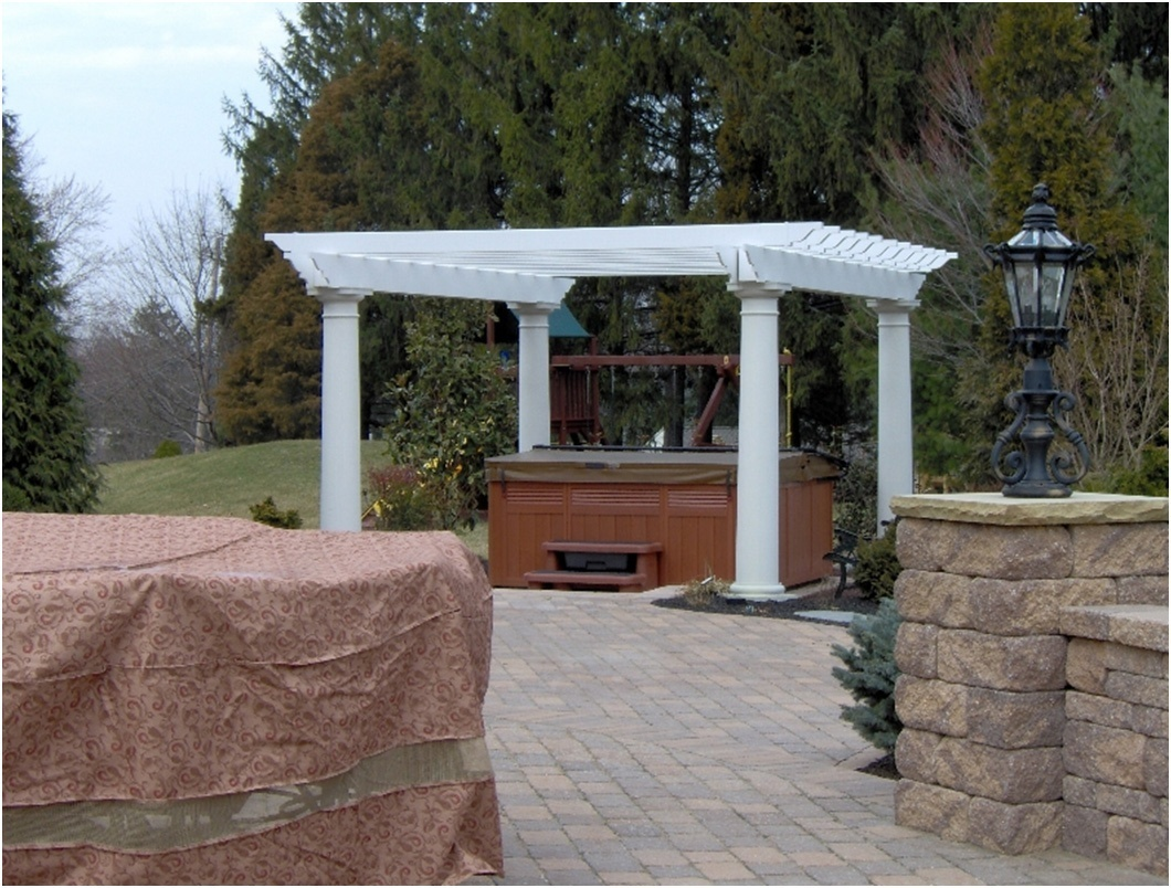 creating a wooden pergola design as the perfect hot tub