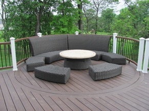Curved deck designs bring unbroken rhythm to backyard decks for Definition of a balcony