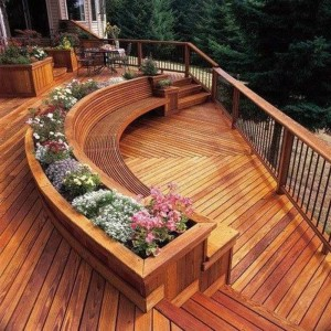 curved deck bench with flower pots
