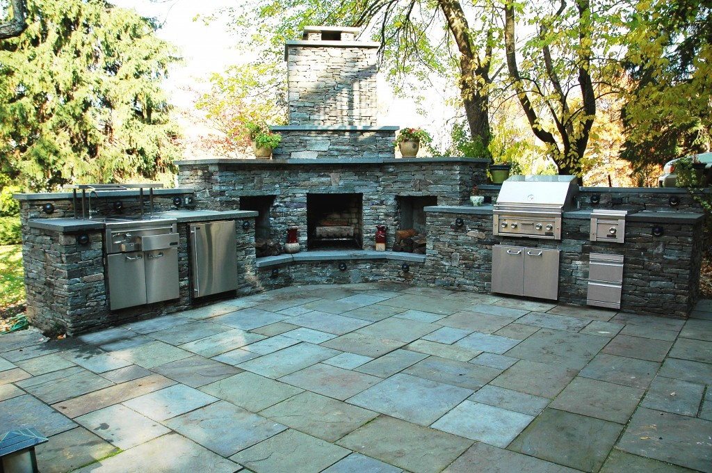 outdoor patio kitchen and stone custom fire place with chimney- Amazing Deck